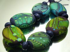 Moogin - lampwork bead set etched blue and green toned batik style SRA 35x25mm
