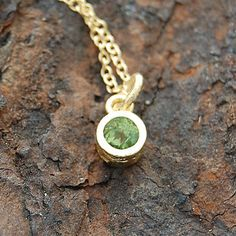 Gold And Peridot Dot Green Necklace - A stunningly simple and elegant pendant featuring a single semi precious stone in a naturally textured gold setting. Reminiscent of Elizabethan or Tudor jewellery. #Embersjewellery #Jewellery #MotherDay #Present