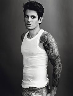 An amazing voice, incredible guitar player AND tattoos?  Impossible to resist.