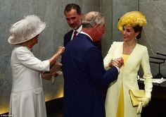 Letizia (far right) wore a bright yellow coat over a matching dress and an elaborate headpiece ahead of today's meeting, while the Duchess of Cornwall opted for a white hat adorned with feathers