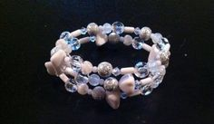 Light Grey, Clear, and White Large Memory Wire Bracelet. Please visit my facebook page called The Pelican By Kristin Margarite. https://www.facebook.com/ThePelicanbyKristin/?ref=aymt_homepage_pane
