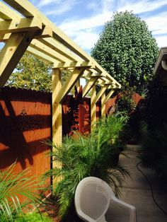 This client as you can see as a long narrow backyard, she wanted shade but did not want to plant trees! So my solution was, call my carpenter and build half a pergola .. She cannot be more happy! Perry Stelly exterior designs