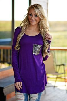 Long sleeve top with a sequined silver pocket. Has a looser fit, so if you're in between sizes order down. Small 0-5 Medium 6-9 Large 10-13 Model is 5'5'' a size 0 wearing a small.
