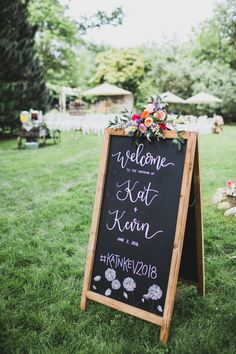 """""""We wanted everything to feel like a big party in our backyard,"""" Kathleen Mooney and a board game manufacturer) says of her laid-back wedding to K Garden Party Decorations, Wedding Decorations, Wedding Ideas, Chalkboard Welcome Signs, Mini Carnations, Laid Back Wedding, Spring Wildflowers, Spray Roses, Big Party"""