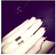 Maroon nails and Cartier Love rings