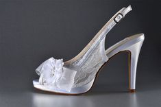 This fun slingback platform pump with silk flower looks great in white lace or dyed to match your outfit for any special occasion! This shoe features a cute peeptoe and an adjustable strap with buckle for optimal fit.  Dye this bridal shoe to any of our 250 colors for the bride or the bridesmaids at no extra charge! This bridal shoe can be dyed to match Davids Bridal Shop and many other shops as well or I can match your color swatch! This bridal shoe comes with a 3 1/2 heel and sizes in...