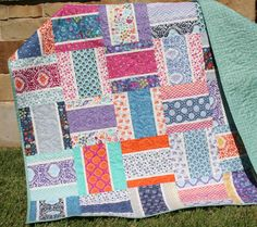 This pattern includes instructions to create both a baby quilt and a throw sized quilt. For a baby quilt 38.5x48 it requires 20 10inch squares (or half of a layer cake), 1/3 yard for pinstripe, 1/2 yard for binding, and 1.5 yards for backing, and batting of your choice in a crib size. For the larger throw 57.5x67 you will need 42 10inch squares (or one layer cake), 2/3 yard for pinstripe, 3/4 yard for binding, 3 1/4 yards for backing, and batting approximately 64x73.    Check out one of kind…