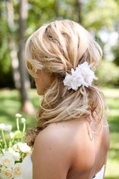 Another side swept ponytail with flower