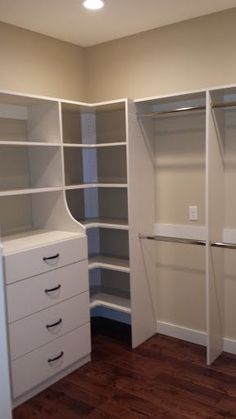 Master Closet – small walk in closet with hanging storage, drawers, and shelving More
