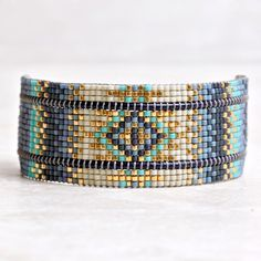 Denim blue and aqua come together in our handmade Hebe Bracelet. Mishky uses specialty square beads that fit together perfectly to create a smooth bracelet that