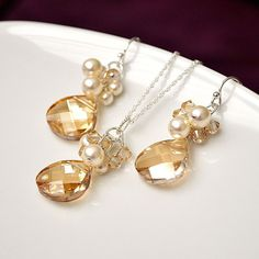 Bridesmaids Jewelry Sets. Crystal Earrings Necklace SET. Golden Crystal & Ivory Pearl Jewellery for the Fall Wedding Bride or Bridesmaids. $102.00, via Etsy.