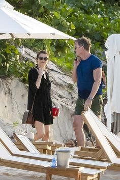 Downtime:Earlier in the day she had covered up in a baggy black shirt that showed off her toned legs as she strolled along the coast with her hubby