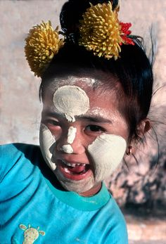 12. Little girl happily playing among the payas in Bagan