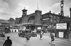 The exterior of King's Cross station Cars and people coming and going outside the station Reid an amateur photographer of independent means began an...