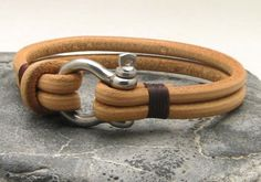 O1 - Men's natural leather rope bracelet with silver plated horseshoe clasp.
