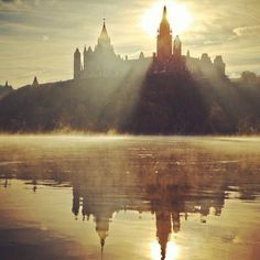 A beautiful mirrored image of Parliament Hill and the Ottawa River. For more information on Ottawa visit www.ottawatourism.ca