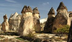 Göreme, Cappadocia, Turkey.  The area around Göreme in central Turkey is covered with hundreds of these fairy chimney formations, which, centuries ago, had homes, churches and monasteries carved into them by the locals. Today, some structures function as hotels, and balloon rides are a hot tourist commodity.