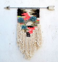 Hand woven tapestry on our welded steel arrow. Tapestry is woven from cotton and wool yarns. Steel arrow is welded and allowed to age and rust, then clear coated. Arrow is long. Woven tapestry is x Weaving Textiles, Weaving Art, Tapestry Weaving, Loom Weaving, Hand Weaving, Art Fil, Weaving Wall Hanging, Wall Hangings, Diy And Crafts