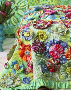 could use baby clothes to make the quilted flowers as a memory quilt?