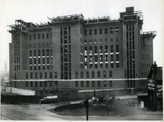A picture of phase one of the construction work on the Main Building (now part of Aston University). The architects' design provided for nine floors, a basement and a deep air raid shelter. The construction was steel-framed (the frame was provided by Darlaston firm Rubery Owen) on concrete pile foundations, with Portland stone dressing on the external walls. This photo is stamped with the date Mar 4 #1954 (the building was opened the following year).