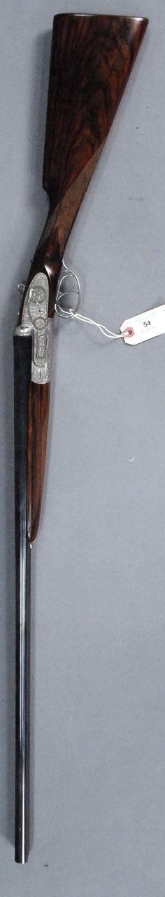 Armis Garbi, model 103, shotgun, William Larkin Moore & Co., side by side, 20 ga., having hand engraved rose and scroll - Realized Price: $4,130.00