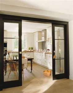 Black Pocket Doors Between The Dining Room And Living Keeps Separate But Adds Light