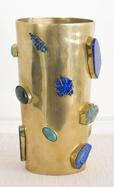 KELLY WEARSTLER   BAUBLE VASE. Burnished brass vase adorned with semi precious…