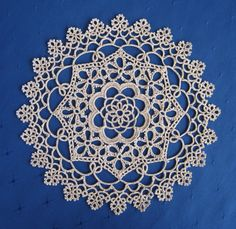 Believe it or not, this doily was tatted by machine, probably in SE Asia