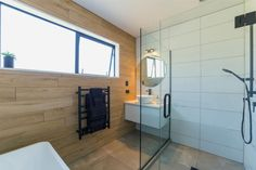 Main bath, bathroom, wooden tiles, black shower, tapware, round mirror