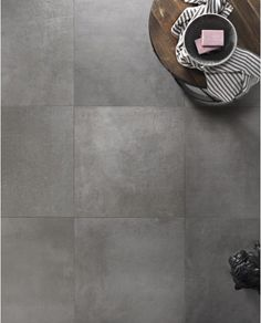 The District collection represents the ideal union of durable, low porosity porcelain stoneware with the modern, monolithic style of concrete. Floor and wall installation provide a contemporary touch, ensuring functionality and technical performance. Concrete Look Tile, Concrete Floor, Urban Beauty, Tile Trim, Wall Installation, Color Shades, Contemporary, Modern, Master Bath