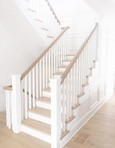 White Staircase. White Staircase. White Staircase Paint color is Benjamin Moore Simply White. #WhiteStaircase #BenjaminMooreSimplyWhite
