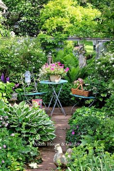 The Aiken House and Gardens, on Prince Edward Island, California. Half hidden ornaments, a path, and even the seating space looks like a private oasis…ff03343075611162331146531a45f423