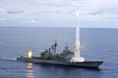 The Ticonderoga-class guided-missile cruiser USS Cowpens (CG fires Standard Missiles (SM) 2 missiles at an airborne drone during a live-fire weapons shoot in the Pacific Ocean in this handout photo taken September 2012 Ticonderoga Class, Go Navy, Us Navy Ships, United States Navy, Aircraft Carrier, War Machine, Battleship, Armed Forces, Fire
