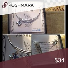 NWT ALEX & ANI Charity Design Angelfish Bangle In support of UNICEF, THIS SILVER BANGLE features an angelfish with black stripes. In original box and on original card. Alex & Ani Jewelry Bracelets