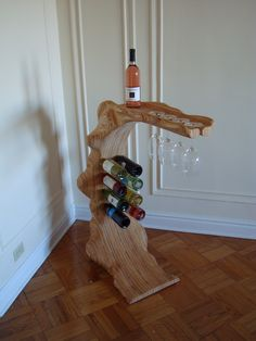 dad could do this out of all that river wood...custom built wine rack