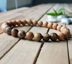 Check out this item in my Etsy shop https://www.etsy.com/listing/507709564/8mm-natural-picture-jasper-bracelet