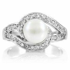 Sterling Silver Freshwater Pearl Ring I would probably faint  if a guy gave this to me it's absolutely  gorgeous