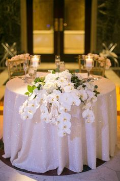 Sparkling Sweetheart Table with Orchid Décor | Photo: Joey Kennedy Photography. View More: http://www.insideweddings.com/weddings/classically-elegant-catholic-wedding-in-pittsburgh-pennsylvania/909/