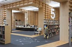 The recent renovation of the Musashino University Library in Tokyo strips the idea of the library down to its most basic element–the bookshelf. That is, the library is constructed as one giant bookshelf, filling every inch of wall-space with more than 100,000 accessible volumes (there are another 100,000 volumes stored in closed-stacks in the basement).