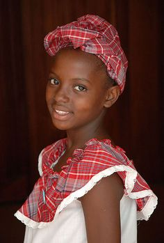 The traditional folk dress is a well loved costume of JAMAICA. It is a beautiful outfit of red & white plaid cotton material which is worn for Independence Galas & other holidays in Jamaica.