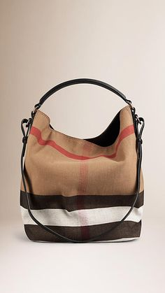Hobo bags are hot this season! The Burberry Bucket New with Defect Canvas Hobo Bag is a top 10 member favorite on Tradesy.