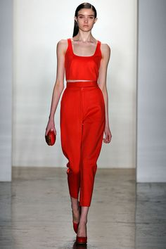 Alexandre Herchovitch - New York Fashion Week A/W 2013 - Red high waisted ankle grazer trousers paired with a matching crop top