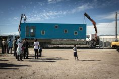 CECILE & BOYD FOUNDATION Blikkiesdorp container delivered on Mandela Day 2012