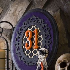Prop this glamourous Halloween vignette on your mantel for some holiday flair that blends seamlessly... - Mod Podge Rocks