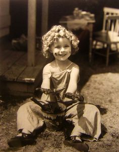 Shirley Temple playing in the mud.