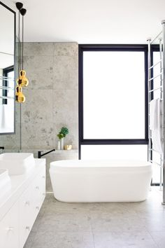 Bathroom Luxury in this master ensuite is sensory. the mim design group chose a pair of omvivo 'latis'...