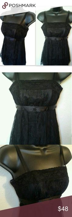 Tripp NYC Corset Top Black Lace Gothic Size XS Get your goth on in this gorgeous rare Tripp NYC corset! New without tags, has spent some time in my closet but has never been worn! Beautiful floral lace overlay, comfortable yet slimming boning to create a sexy silhouette! Back zip closure, no tedious eyelets! Pretty ribbon ties around back. Multiple ways to wear with removable straps!  Size XS. Material is stretchy so could also fit a size S. Tripp nyc Tops Tank Tops