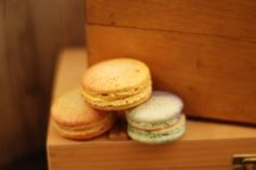 Handpainted Saffron-Orange Blossom macarons on Orange-Pistachio shells and Moroccan Spiced Coffee macarons on vintage wooden boxes. Pistachio Shells, Spiced Coffee, Orange Blossom, Wooden Boxes, Scotch, Macarons, Moroccan, Muffin, Spices