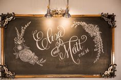 Chalkboard calligraphy sign for entrance to wedding reception