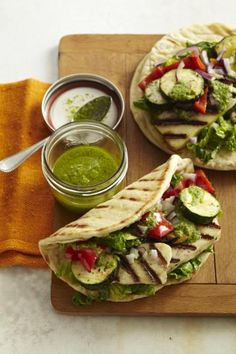 Pesto veggie gyro  Grilled flatbreads are oozing with pesto vinaigrette, juicy veggies, and golden brown cheese in this immensely satisfying gyro recipe.